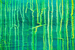 Dripping green paint on canvas background Royalty Free Stock Photography