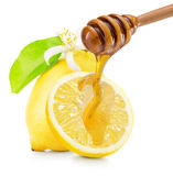 Dripping honey on lemons isolated on a white background.  Royalty Free Stock Photography