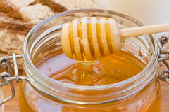 Dripping honey Royalty Free Stock Image