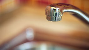 Dripping kitchen faucet stock video footage