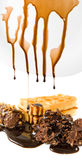 Dripping liquid chocolate candy close-up Stock Photo