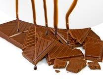 Dripping liquid chocolate on chocolate Royalty Free Stock Image