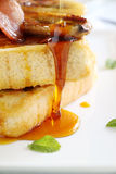 Dripping Maple Syrup. Maple syrup dripping down caramelized banana and french toast Stock Photo