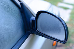 Dripping on Mirror and window of the car Royalty Free Stock Image