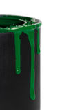Dripping Paint. Dripping green paint on the side of can Royalty Free Stock Photography