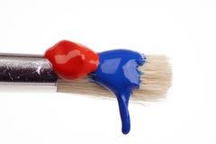 Dripping paint brush Stock Photo