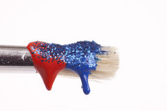 Dripping paint brush with glitter. Paint brush dripping with different coloured paints Royalty Free Stock Photo
