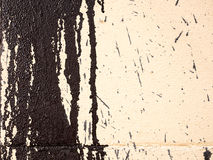 Dripping paint at an wall, texture. Royalty Free Stock Photography