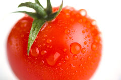 Dripping red tomato Royalty Free Stock Photo