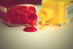 Dripping Red and Yellow Nail Polish Royalty Free Stock Photography