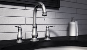 Dripping tap stop wasting water Royalty Free Stock Image