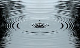 Dripping water and rings. Drops of water into pond making rings Royalty Free Stock Photography