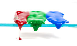 Dripping wax of three primary colours. On transparent glass stock image