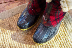 Dripping wet snow boots Stock Photos