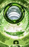 Dripping Wet Vibrant Green Bottle royalty free stock image