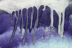 Dripping white, blue paint on purple  metal surface 5 Stock Photo