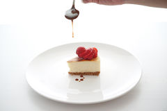 Drippingg caramel on sliced cheese cake Stock Photos