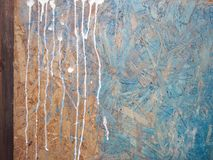 Drips Of Colors. On a painted grunge surface, cropped closeup Royalty Free Stock Image