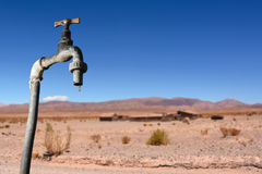 Drips Faucet And Dry Environment In The Background Royalty Free Stock Images