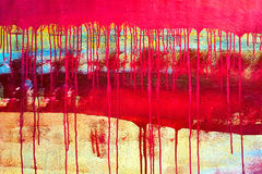 Drips of red paint on canvas background Royalty Free Stock Images