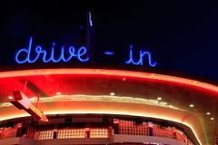 Drive In. A retro diner all lit up at night with bright neon signage Royalty Free Stock Photography