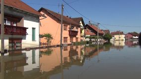 Drive across flooded streets with boat. Flooded fields, villages, farms and houses. Aftermath of devastating river flood and lands. Lide. Catastrophic Southeast stock footage