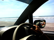 A drive on the beach. A view from inside of a car cruising on the beach Royalty Free Stock Image