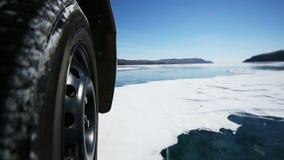 Drive the car across the frozen Lake Baikal stock video footage