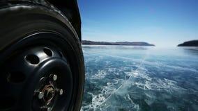 Drive the car across the frozen Lake Baikal stock footage