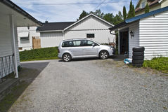 Drive the car into the garage. A friend of mine comes home from a short drive and park his car in the garage, image is shot in Halden municipality, Norway Royalty Free Stock Photos