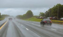 Drive car in rain on asphalt wet road. Cars the traffic light royalty free stock photography