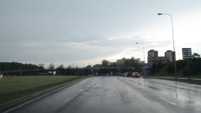 Drive car rain crossroad stock video footage