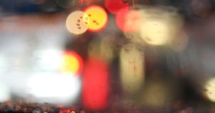 Rain drop on windshield with blur light of vehicle car on traffic jam stock video