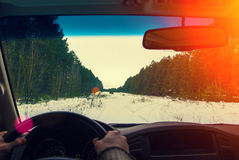 Drive the car on a snowy road Stock Images