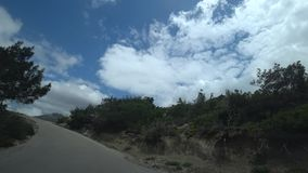 Drive by car on a steep mountain road. Narrow dangerous road view from the car