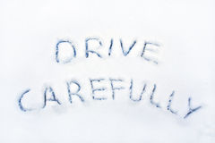 Drive carefully. The words drive carefully written in snow royalty free stock images