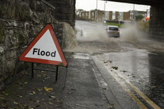 Drive carefully. Generic Image of a UK car attempting to make its way through flood water royalty free stock photos