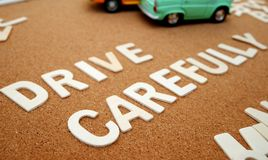 `Drive carefully` writing with wooden letter Royalty Free Stock Photography