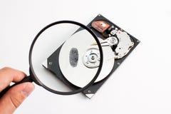 Drive del hard disk con la lente e l'impronta digitale Immagini Stock Libere da Diritti