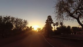 Drive through dramatic Arizona Papago Park Buttes towards Phoenix at sunset. Drive through dramatic Arizona Papago Park Buttes towards Phoenix at sunset towards stock video footage