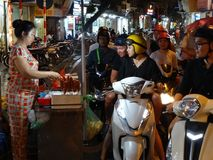 `Drive-in` food stall at Hanoi`s Old Quarter. Busy time on the night yime at streets of the Old Quarter in Hanoi, Vietnam Stock Photos