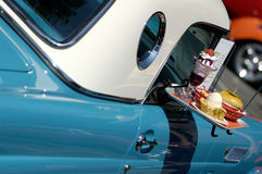 Drive Through Meal. Old classic car with burger order on window stock images