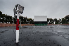 Drive in movie area with screen and speaker poles. Parking area for a drive in movie with screen and speaker poles Stock Photography