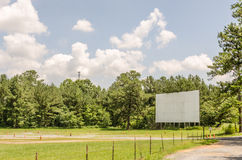 Drive-in Movie Screen. Drive-in theater movie screen that looks quite lonely without the speakers Stock Photos