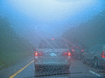 Drive in rain Royalty Free Stock Images