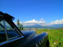Drive-In Reality Show. '49 Buick overlooking a beautiful valley stock image