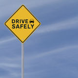 """Drive Safely. """"Drive Safely"""" sign on a blue sky background (with copy space Royalty Free Stock Image"""