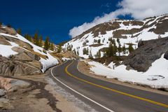Drive safely. View of the mountain road in the winter stock photo