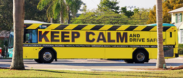 Drive Safely. Keep calm and drive safely written on a yellow bus in Delray, Florida stock photography
