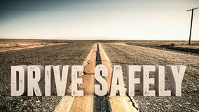 Drive safety. 3d illustration of an advertise sign on a desert road Stock Photo